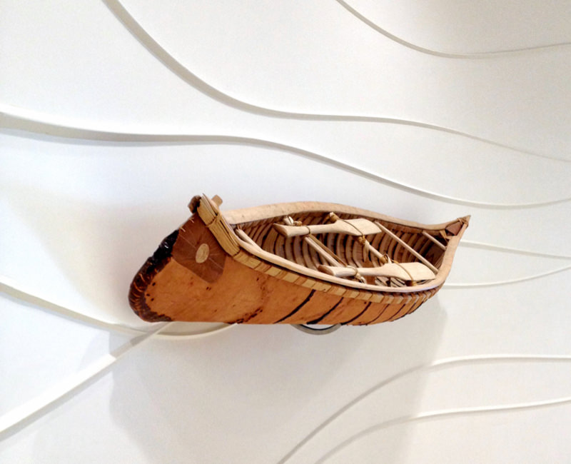 birch bark canoe on display in a gallery
